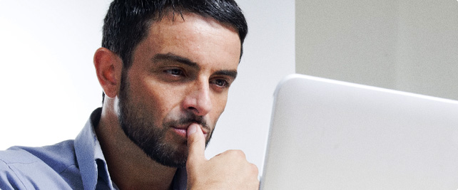 Man researching frequently asked questions about divorce on computer
